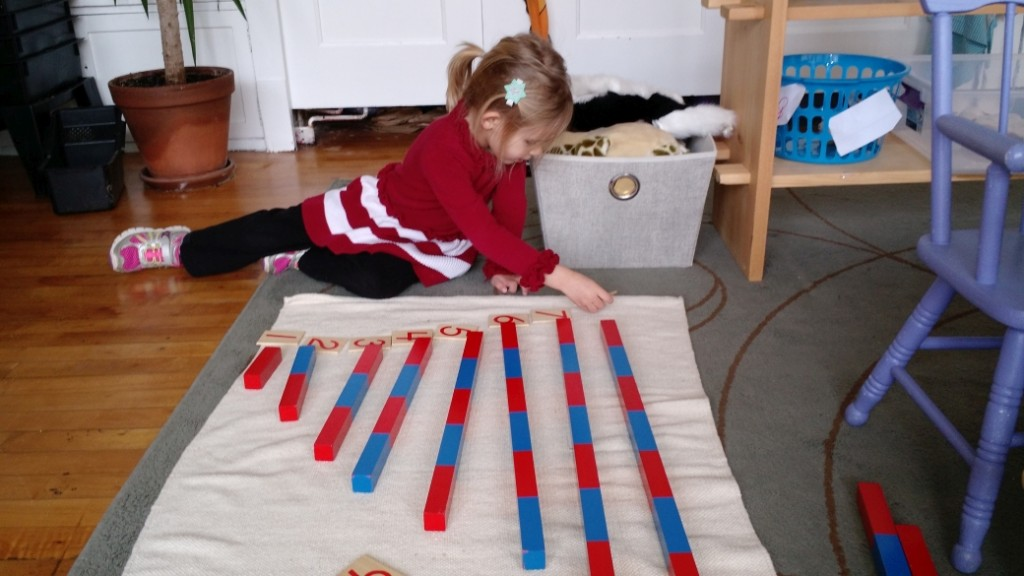 A student works with the number rods to develop concept of number.